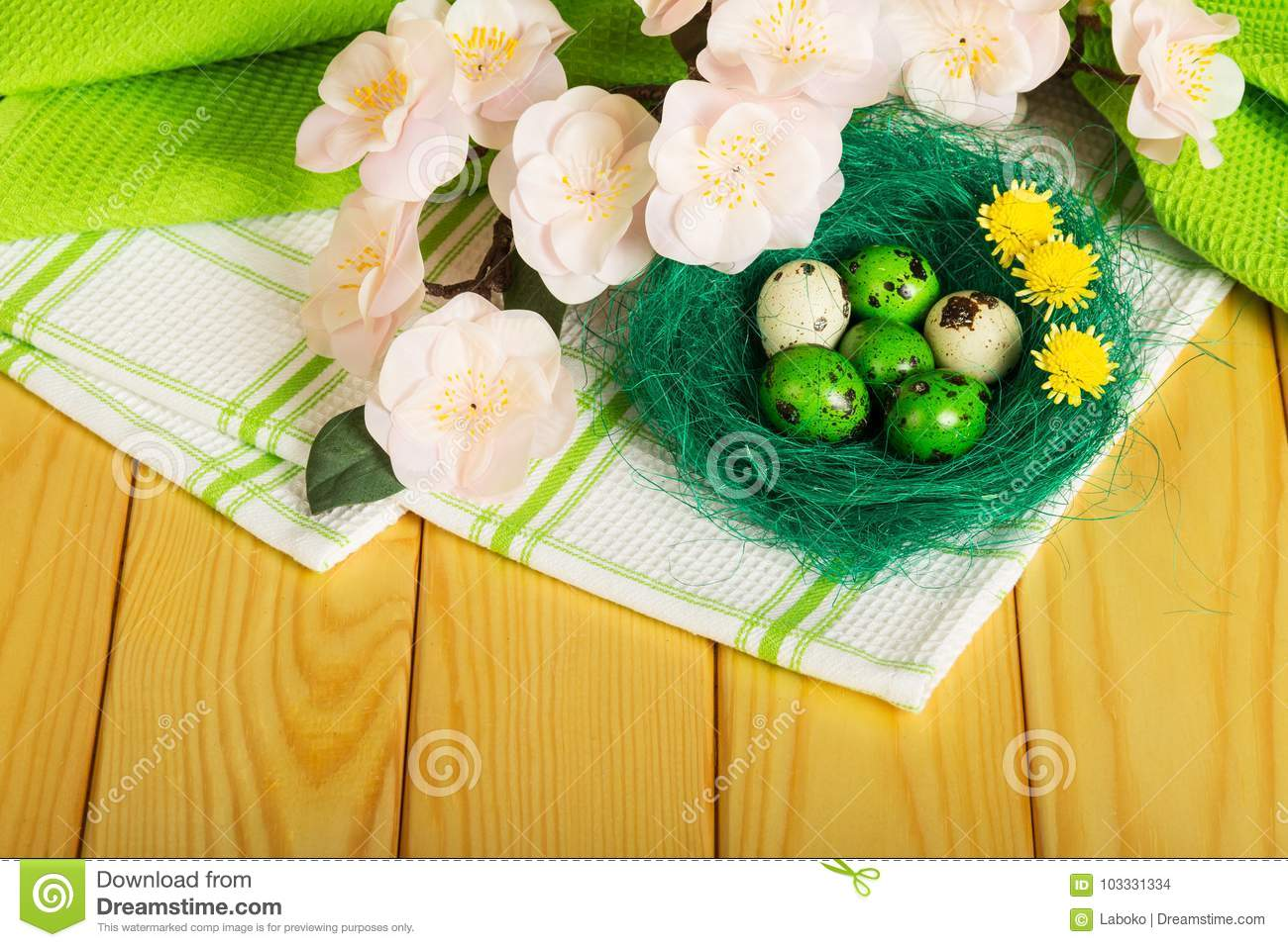 Easter eggs in nest , flowers on towel and light tree.