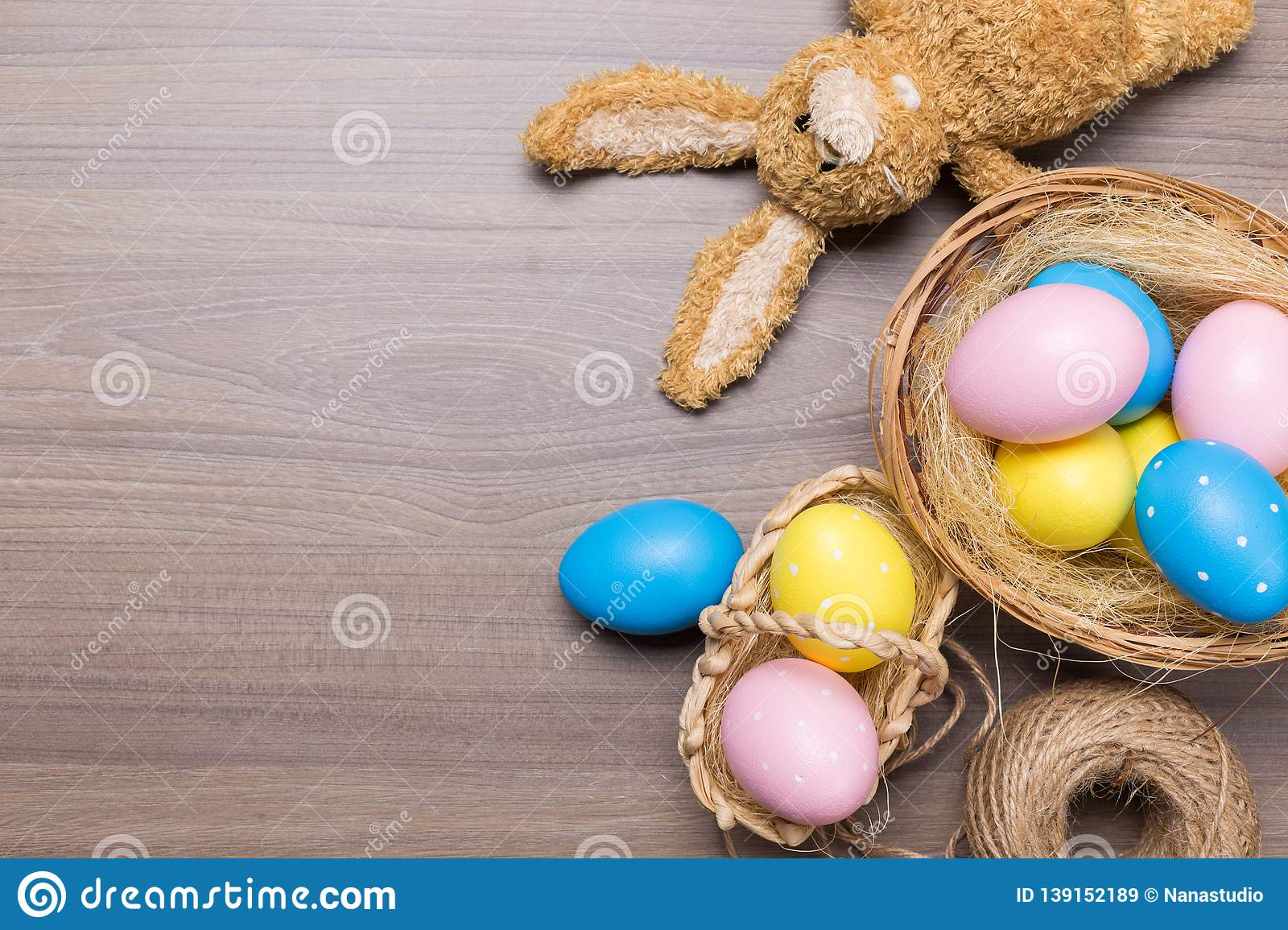 Easter eggs in the basket on wood background