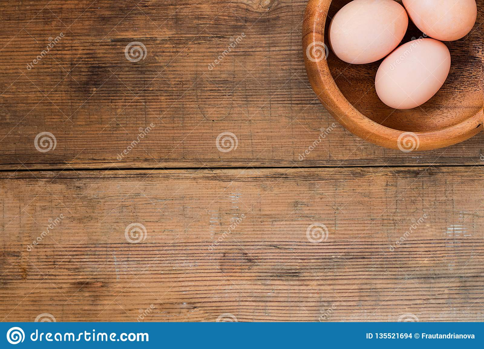 Easter Eggs In Wooden Bowl On Old Wooden Background Stock Photo