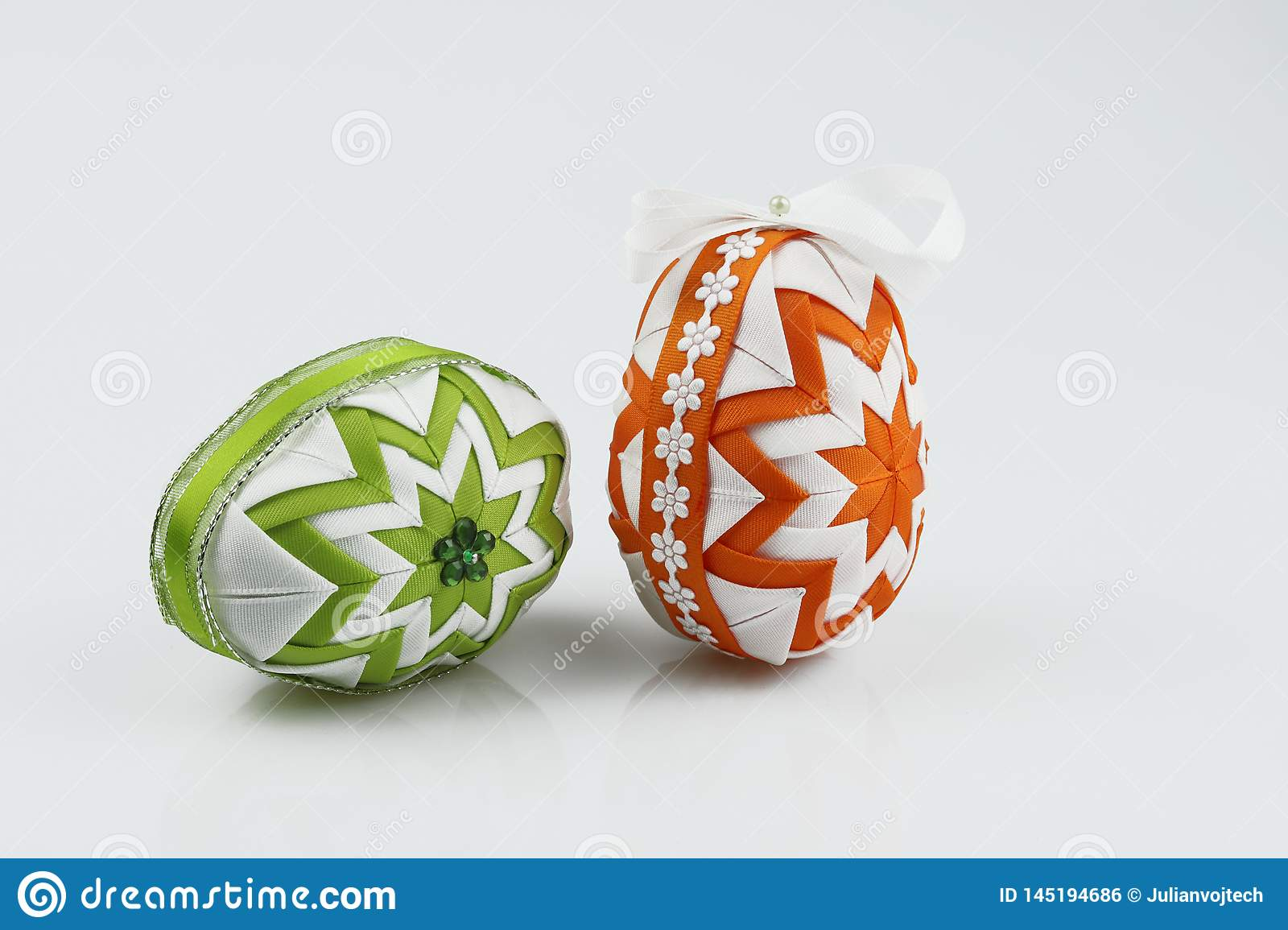 Easter eggs, made in the patchwork technique, isolated on white background