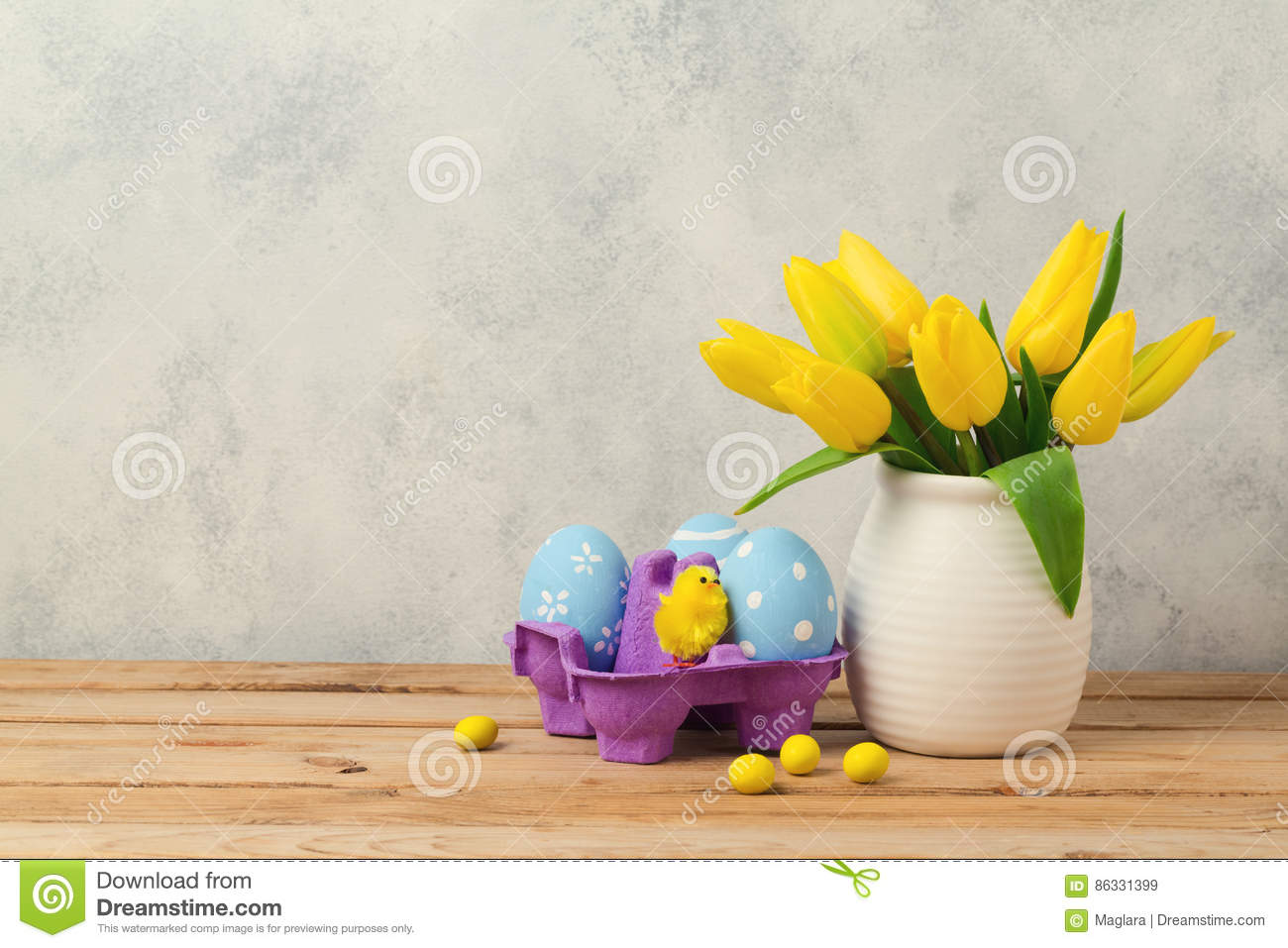 Easter holiday concept with tulip flowers and eggs on wooden table