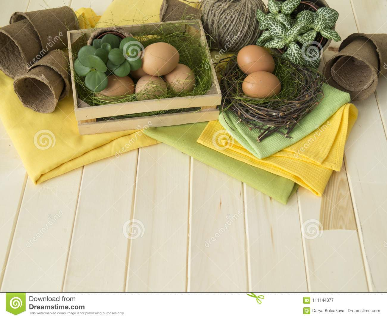 Easter holiday. Decorative Easter arrangement with flowers, plants, pots and eggs. Colors are brown, yellow, green, beige, olive a