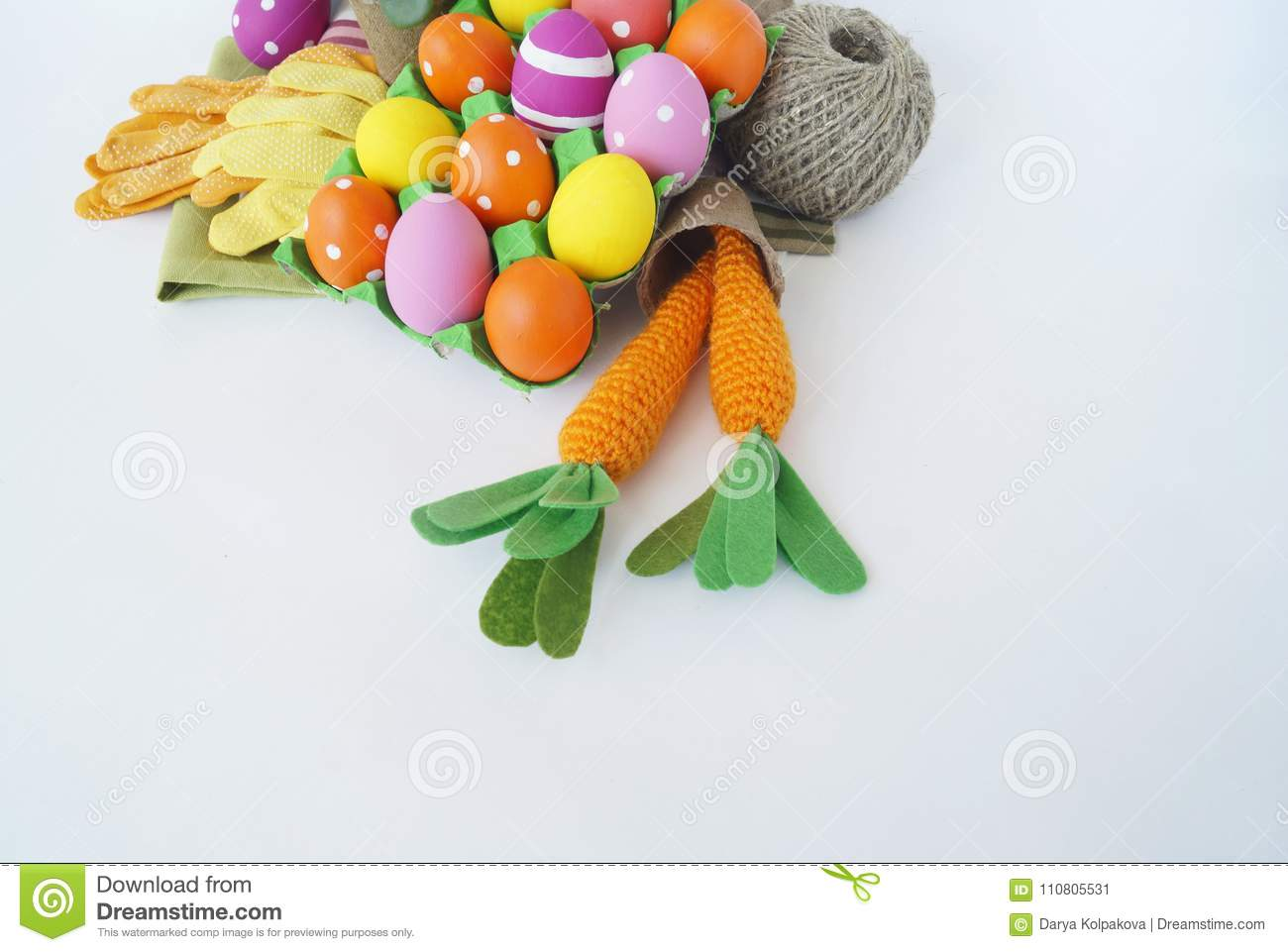 Easter Holiday. Easter Eggs And Carrots. Knitted Carrot. For Planting  Tools. Garden Gloves. Knitting.