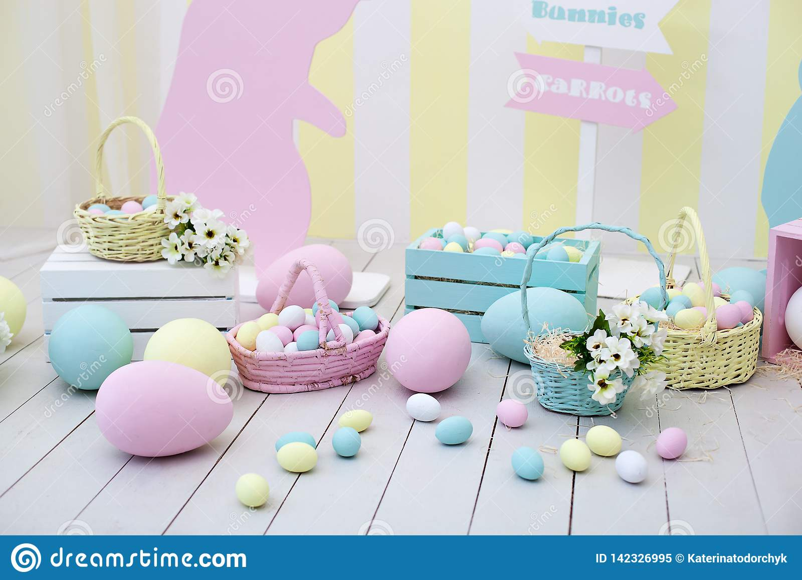 Easter and spring decor. Large multi-colored eggs and Easter bunny.