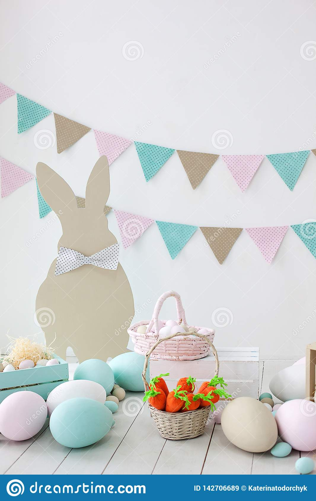 Easter! Many colorful Easter eggs with bunnies and baskets! Easter decoration of the room, children`s room for games. Basket with
