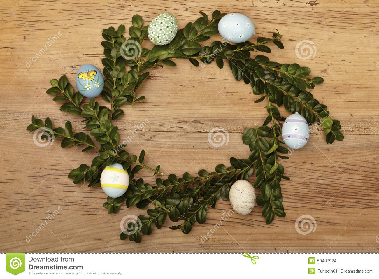 Easter nest with easter eggs on wood