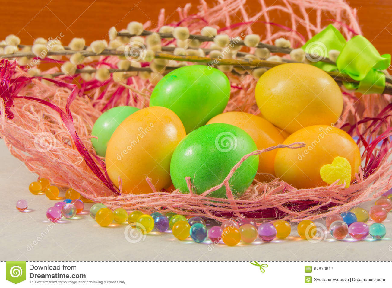 Easter nest with eggs and willows on the table