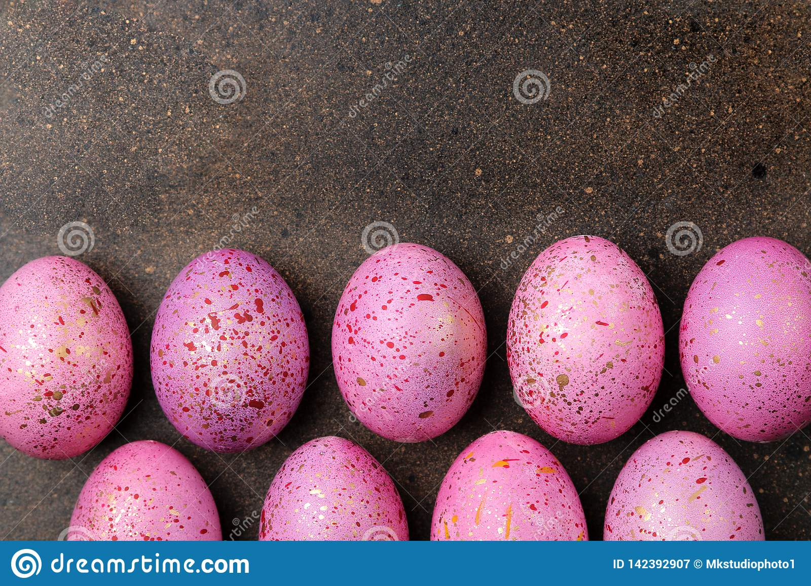 Easter. pink easter eggs on dark background. frame of eggs. Happy easter. holidays. top view. free place