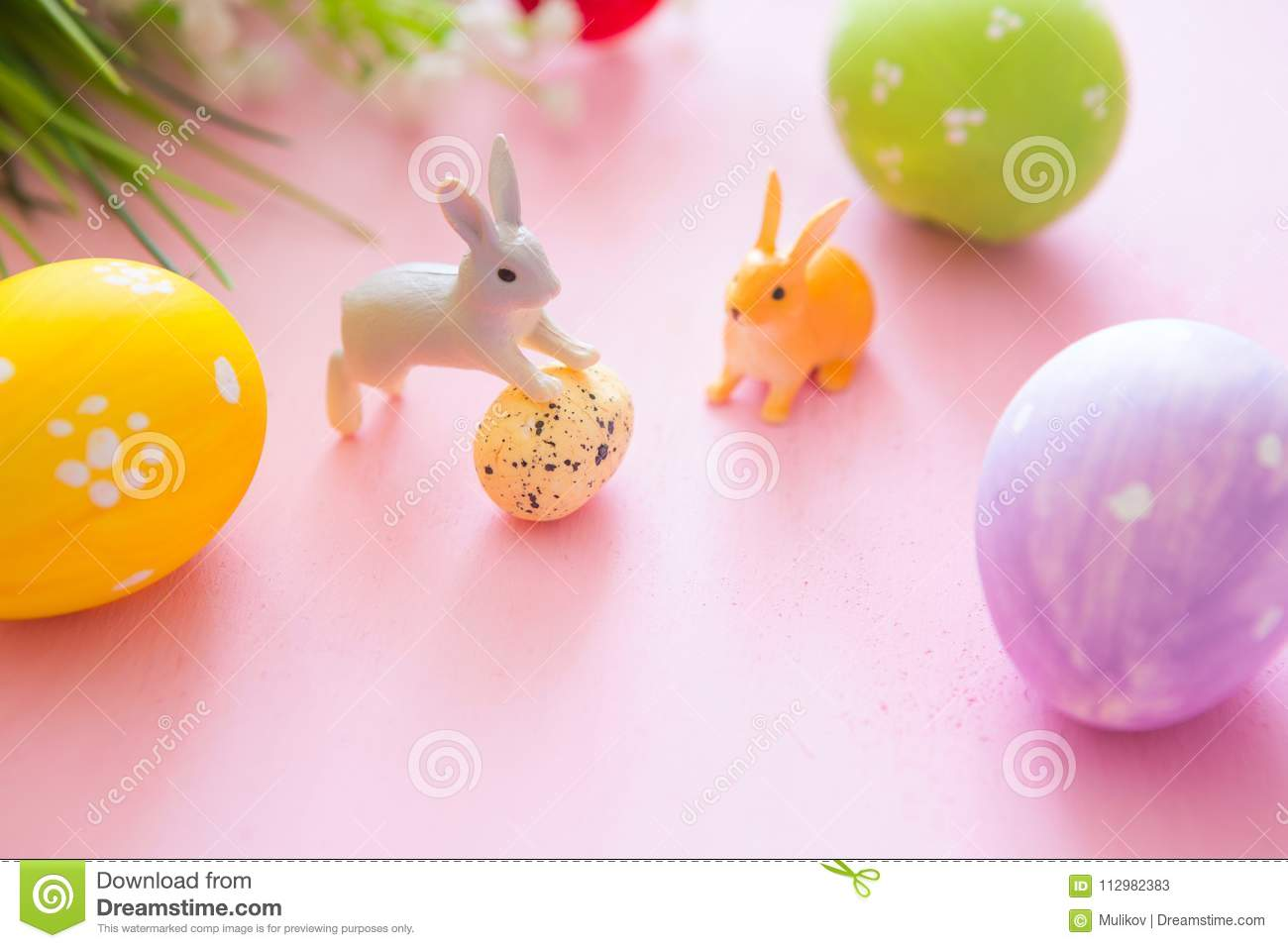 Easter rabbit with Easter eggs on wooden background. Close-up