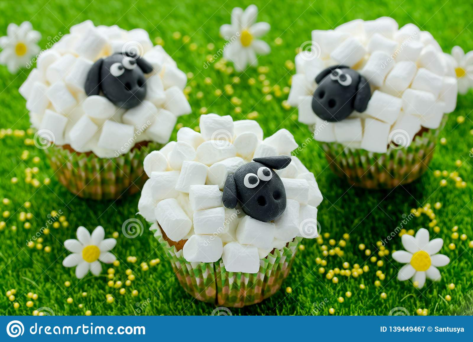 Easter Sheep Cupcakes On Green Grass Background Homemade Cakes Shaped Funny Sheeps With Marshmallow
