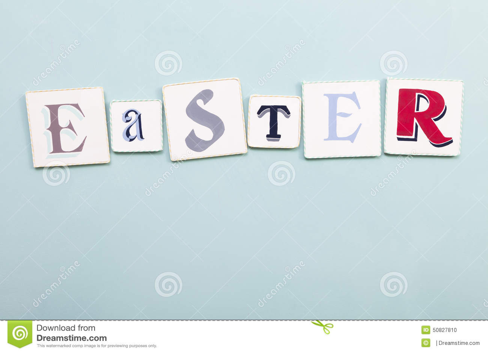 Easter signboard. Handwritten colors letters word. Light blue backgro