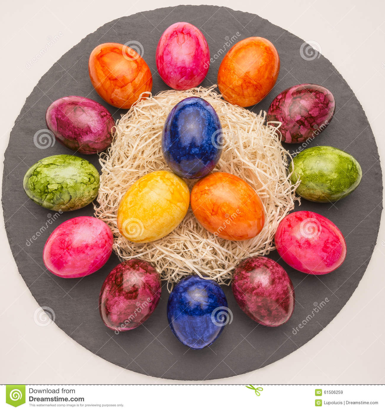 easter or spring themed background with colored eggs stock image