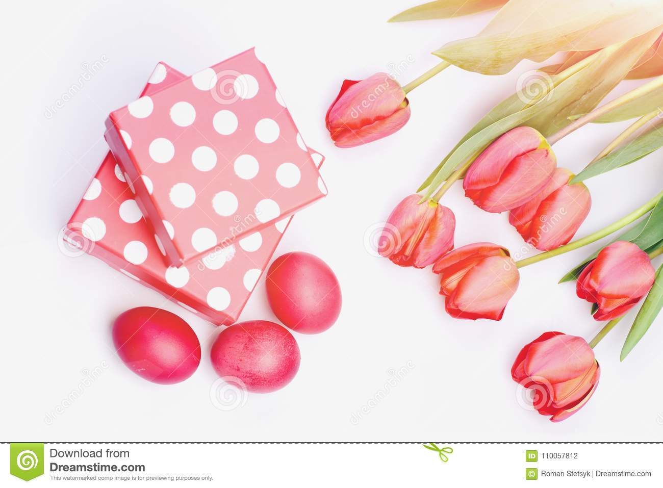 Easter Symbols Concept  Bunch Of Flowers Near Pink Present