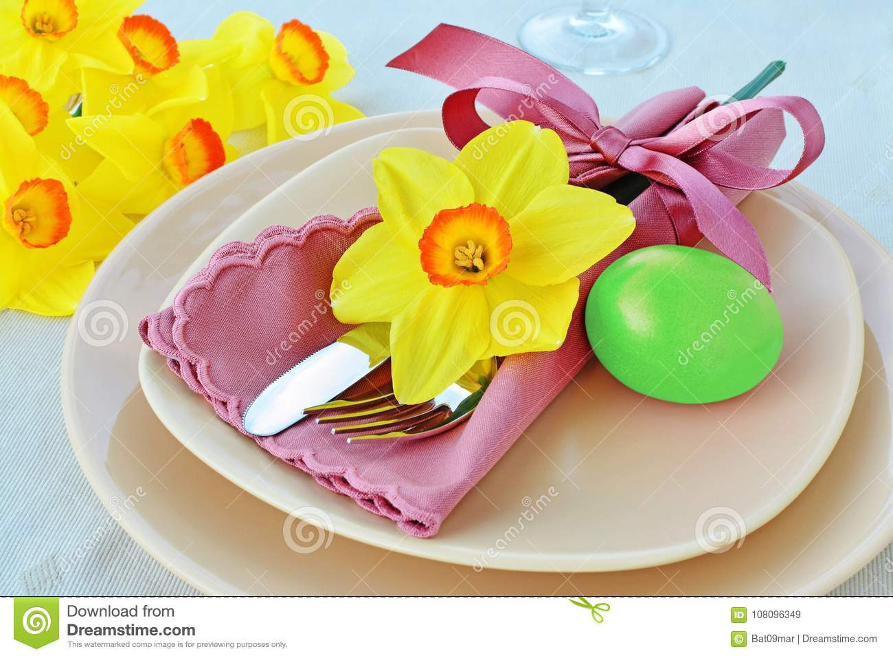 Easter table setting with green dyed egg