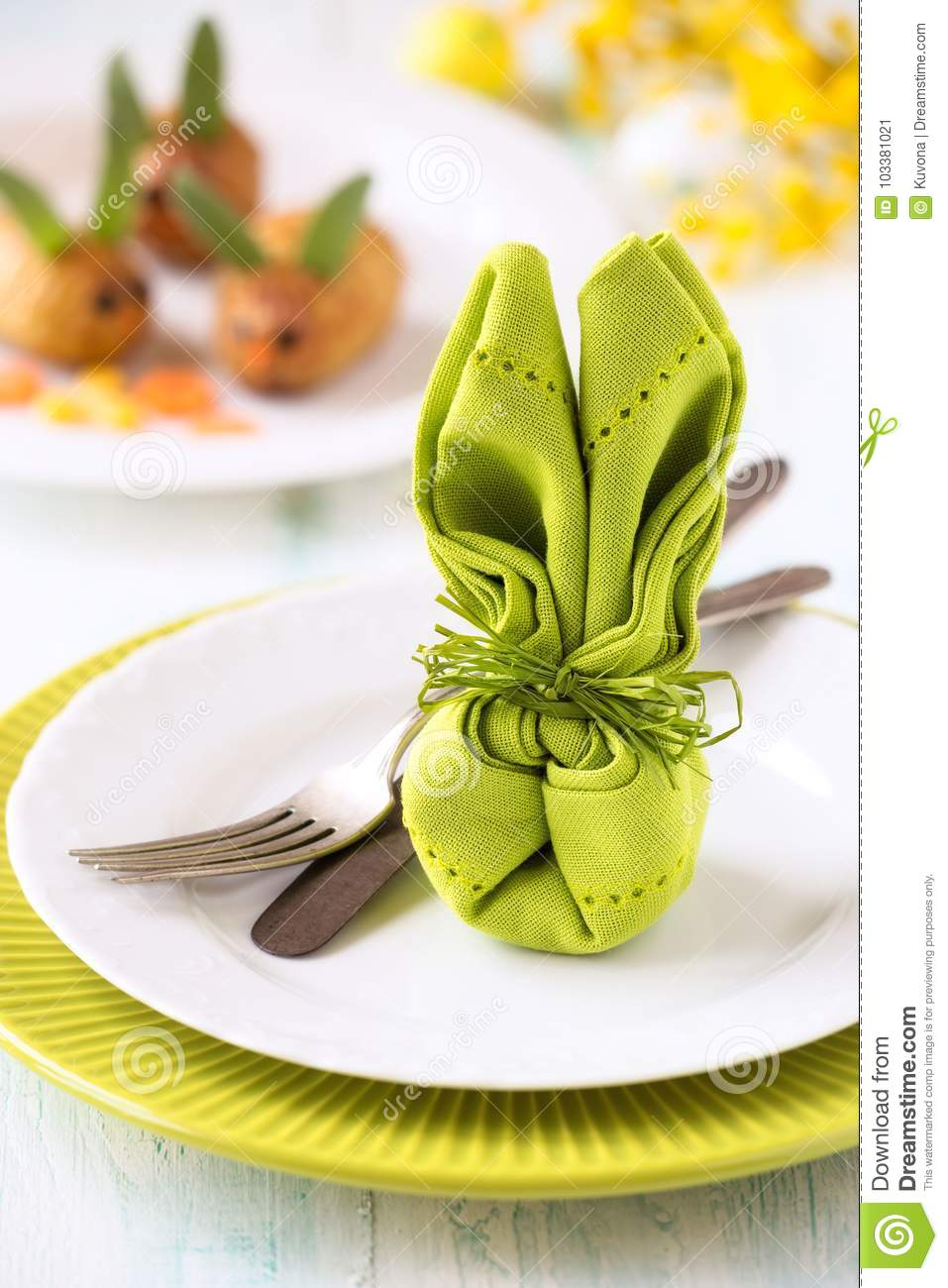 Easter table setting with a napkin folded as a bunny