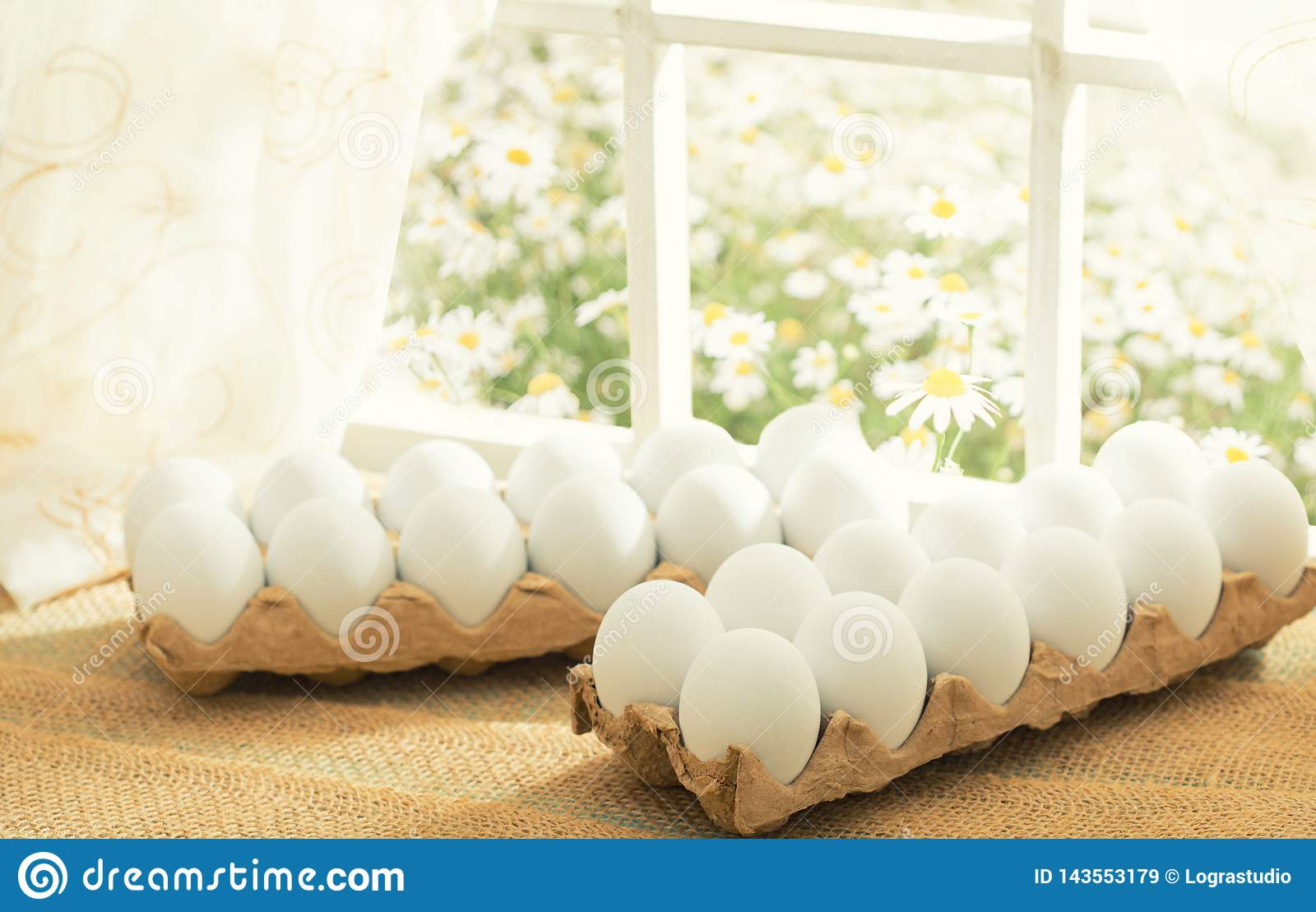 Easter Theme: White Eggs In An Egg Crate On The Window In A