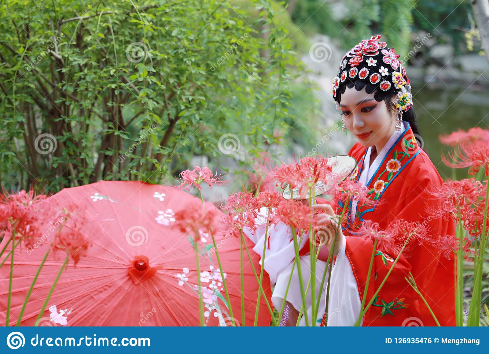 Aisa Chinese woman Peking Beijing Opera Costumes Pavilion garden China traditional role drama play bride hold red Umbrella