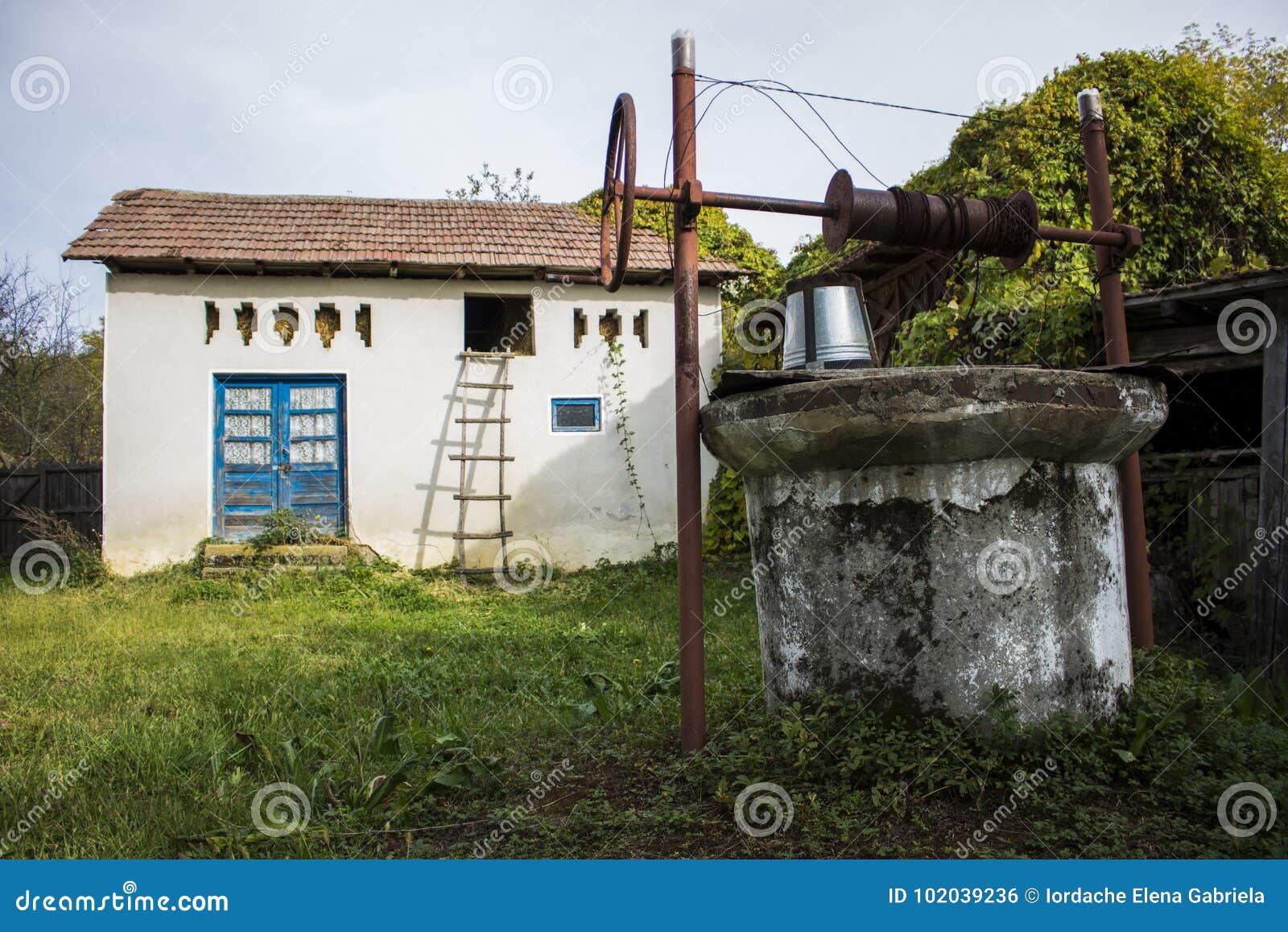 Eastern european barn and well