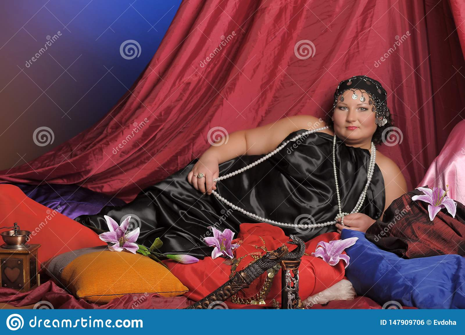Eastern Guria, a well-fed woman in Oriental clothes lies