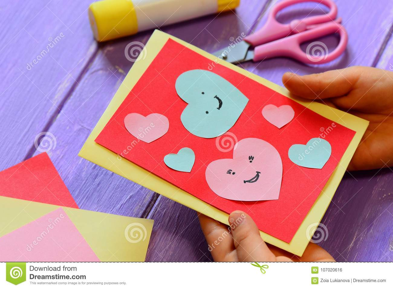 Child Is Holding A Valentines Card In His Hands Child Is Showing A