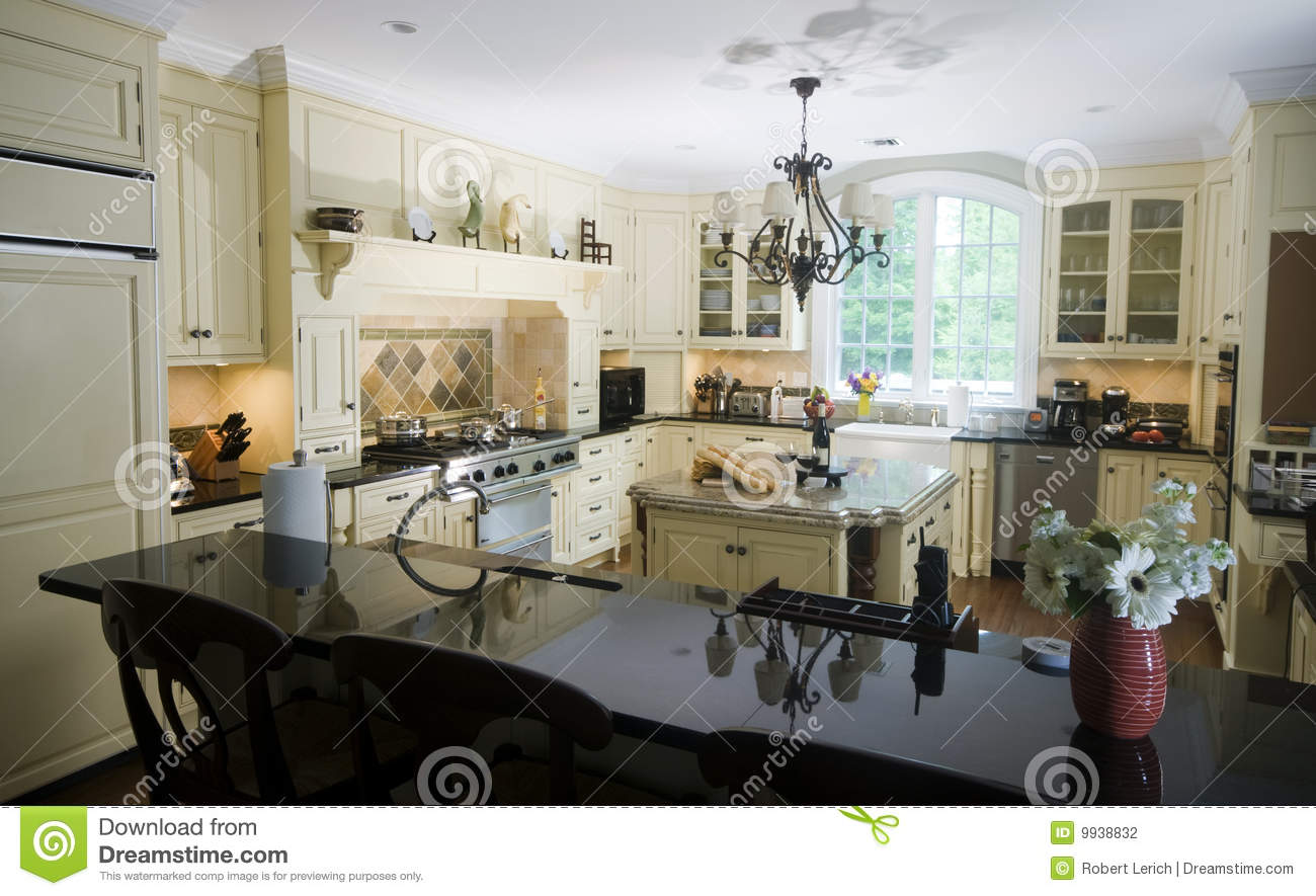 Eat in kitchen with island wine and baguettes stock photo Eat in kitchen island