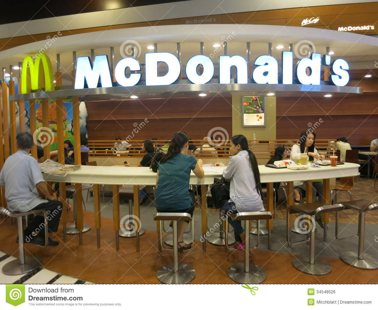 Eating at the cafe in mcdonald 39 s mcdonald 39 s sign and for Eating table