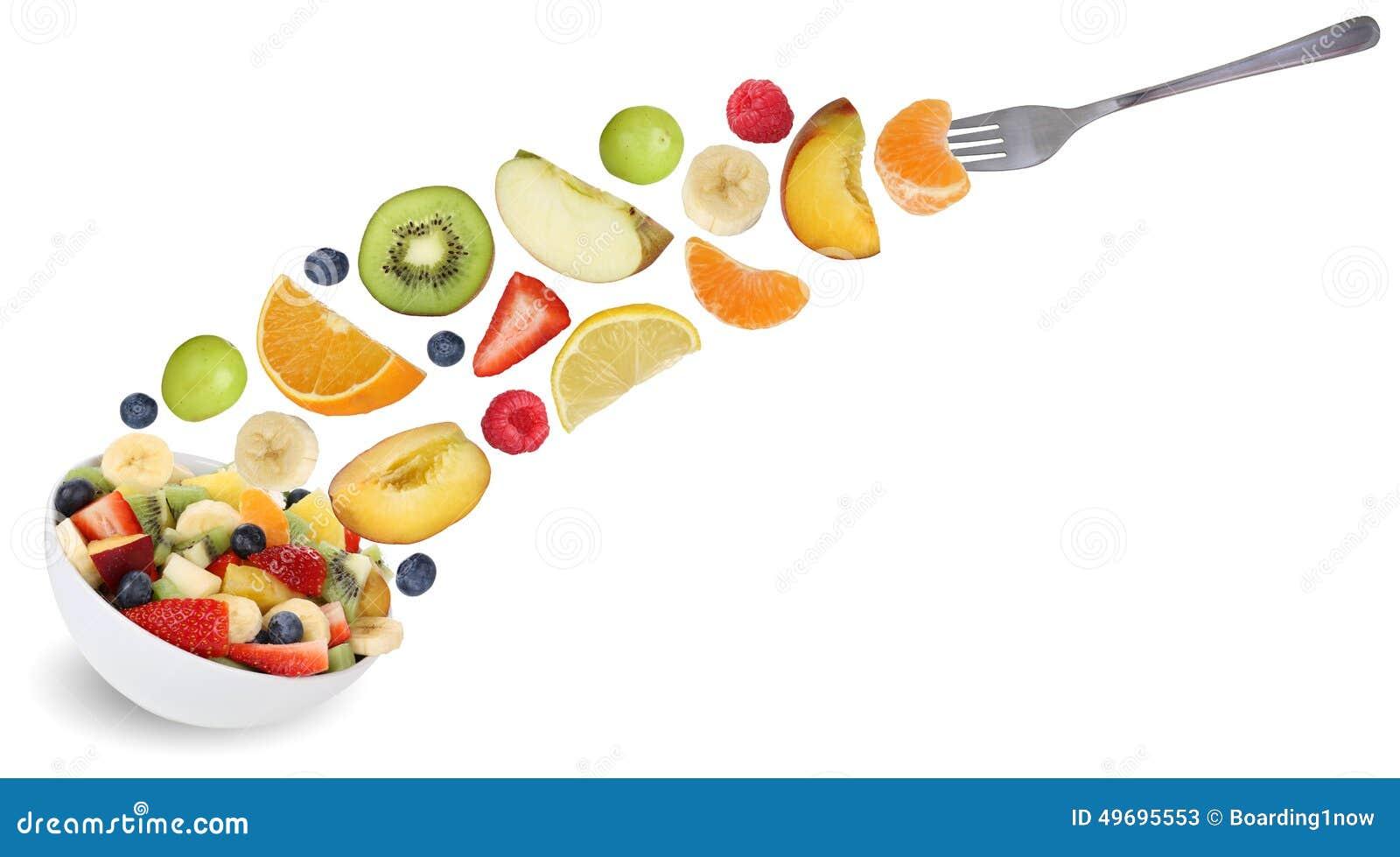 Eating flying fruit salad with fork, fruits like apples, oranges