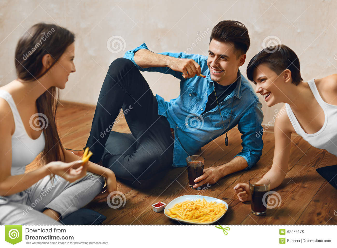 Eating Food Group Of Friends Fast Drinking Soda Stock Photo