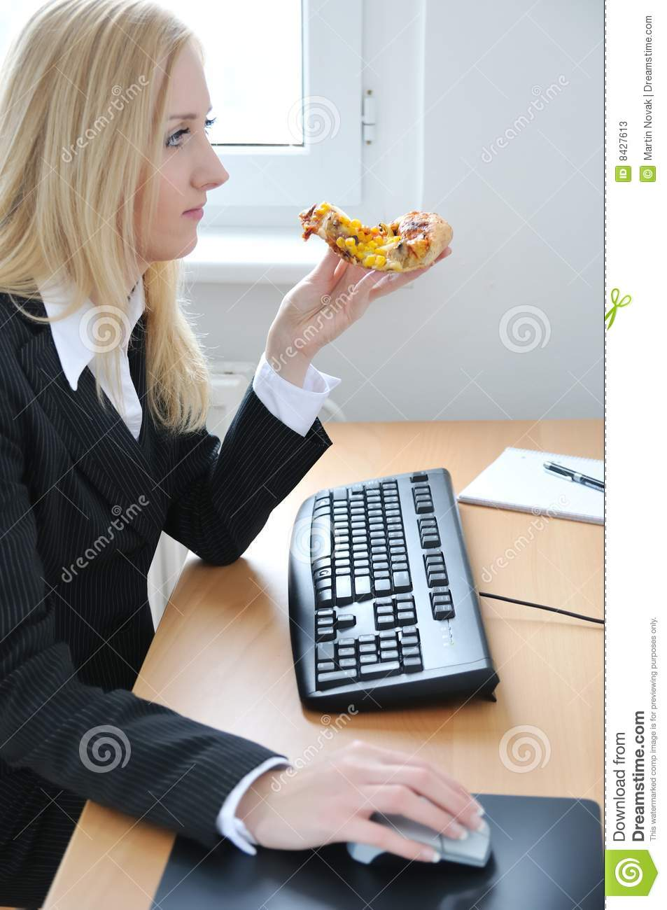 Eating pizza at work