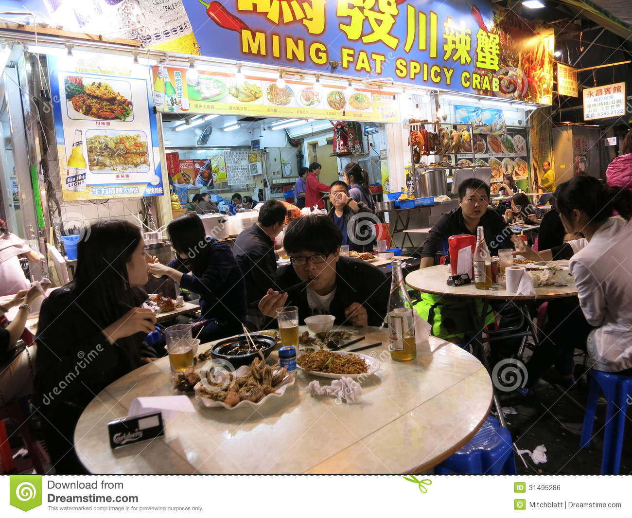Eating Spicy Crab At A Night Market Editorial Photo  : eating spicy crab night market march hong kong people eat outside restaurant temple street hong kong 31495286 from www.dreamstime.com size 1300 x 1065 jpeg 226kB