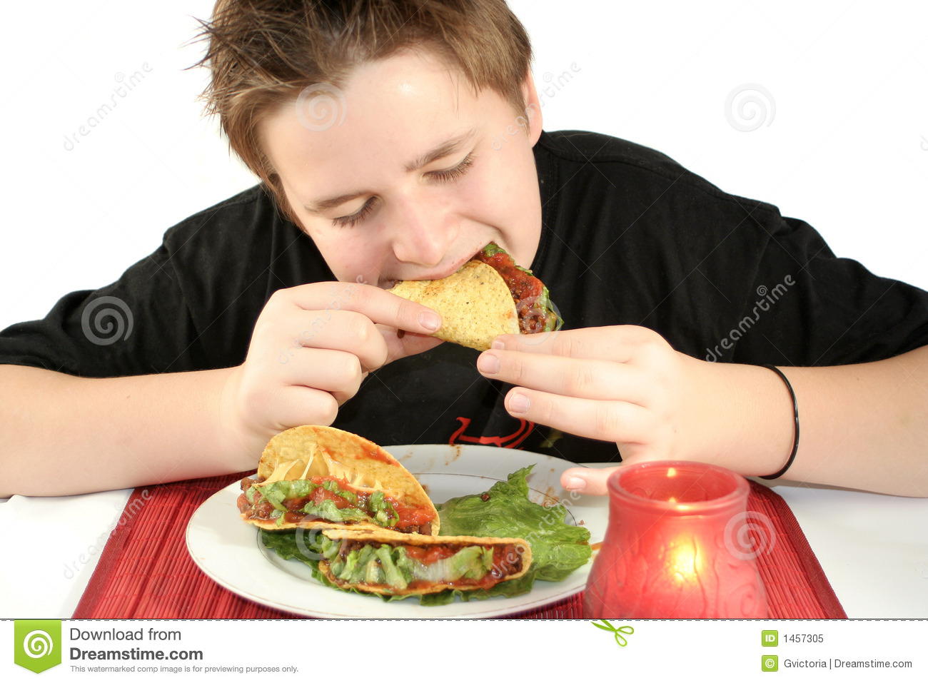 Eating Tacos Royalty Free Stock Photo - Image: 1457305