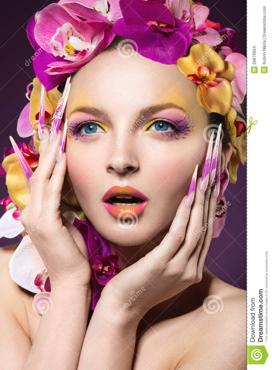 eautiful woman with hair made of flowers and long nails