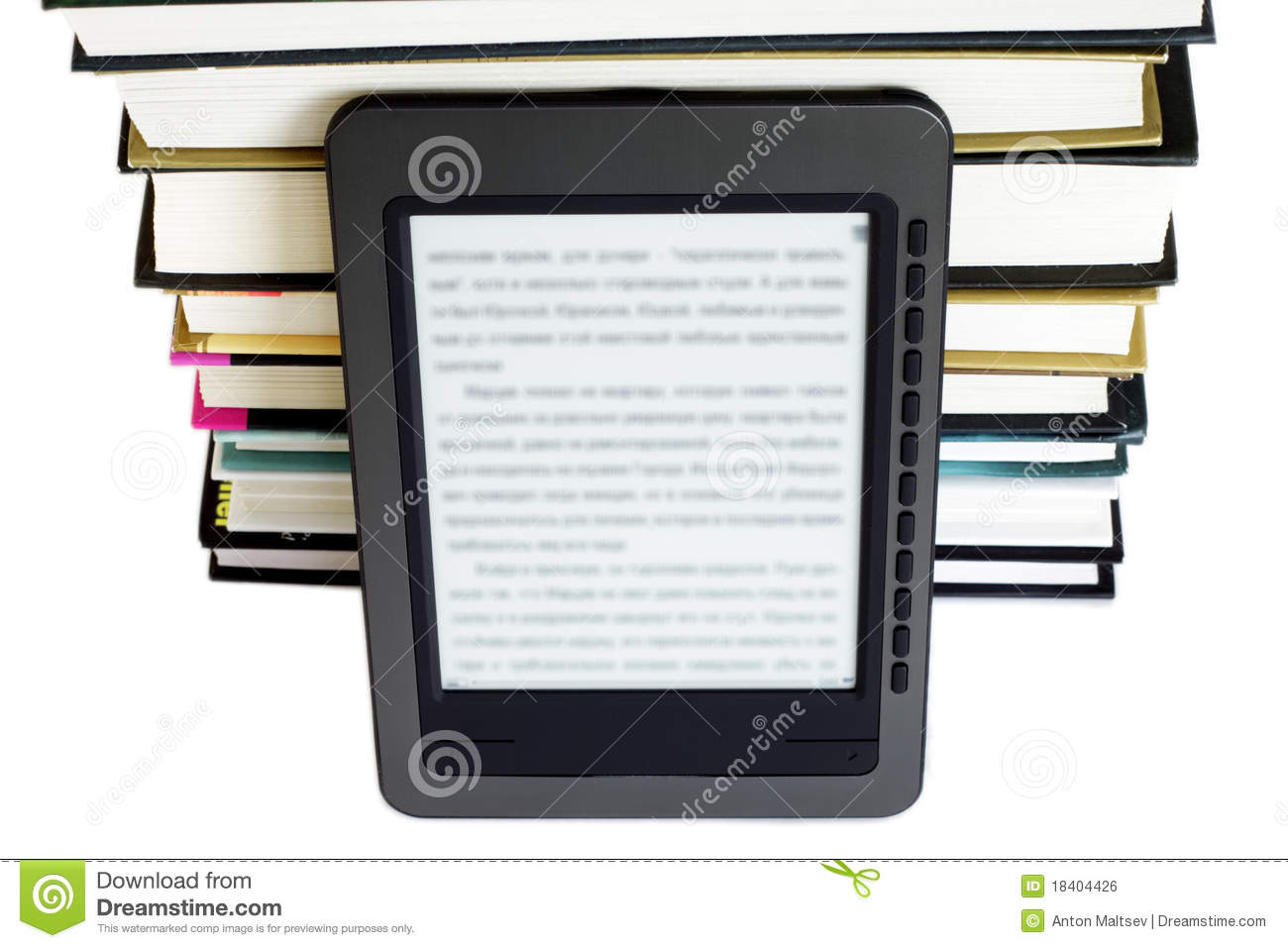 Ebook reader on pile books