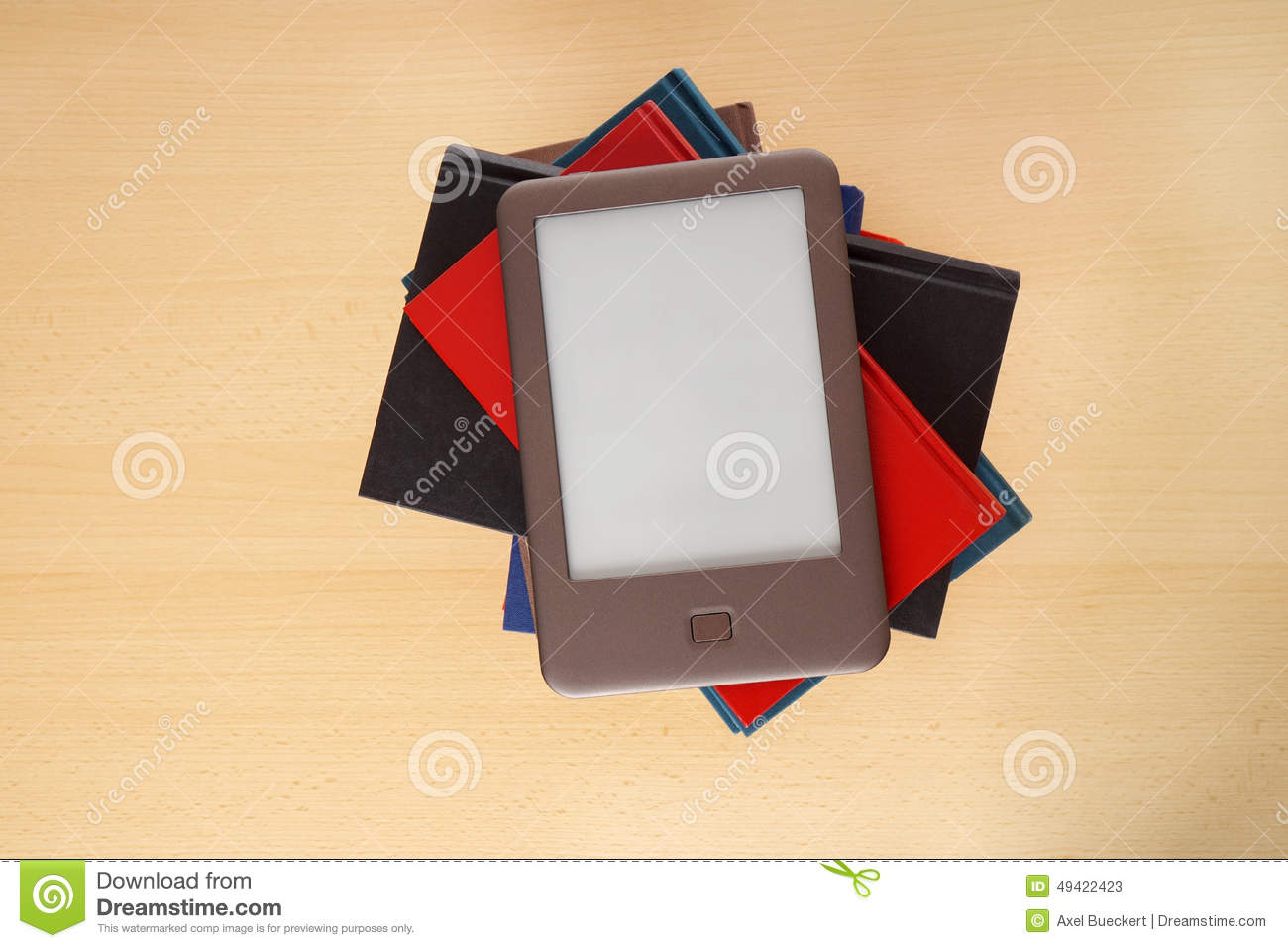Ebook reader on pile of books