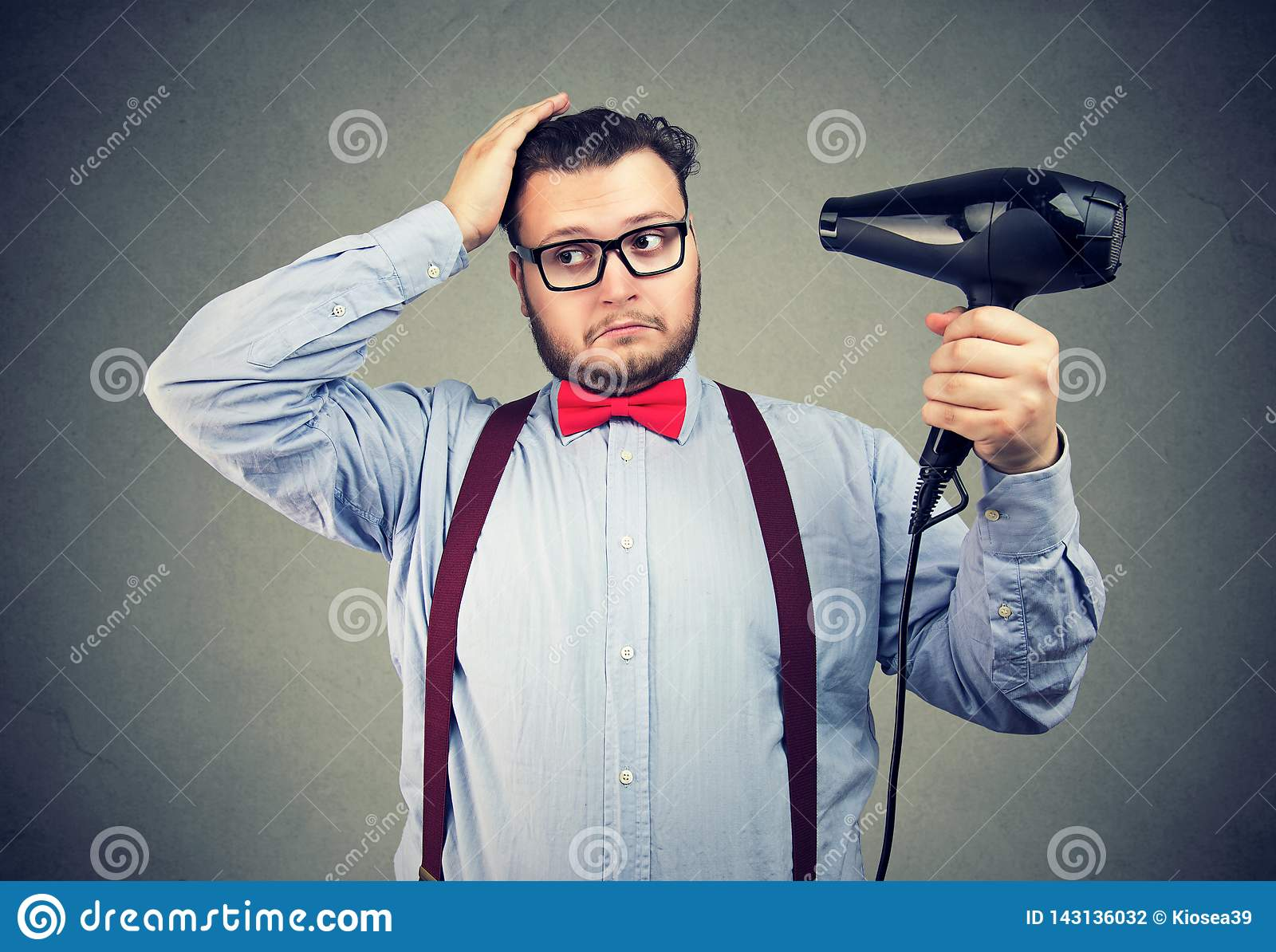 Eccentric man in glasses drying his hair
