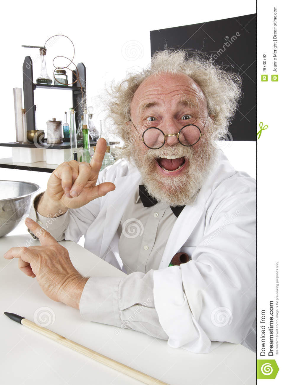 Enthusiastic eccentric senior scientist in his lab, pointing up and ...