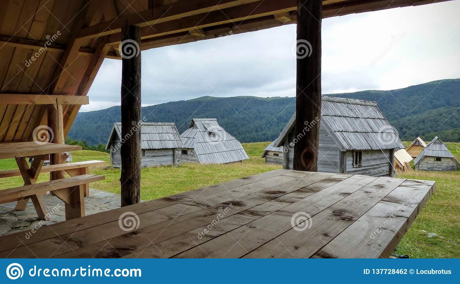 Terrific Echo Village With Wood Houses With In The Foreground A Wood Ibusinesslaw Wood Chair Design Ideas Ibusinesslaworg
