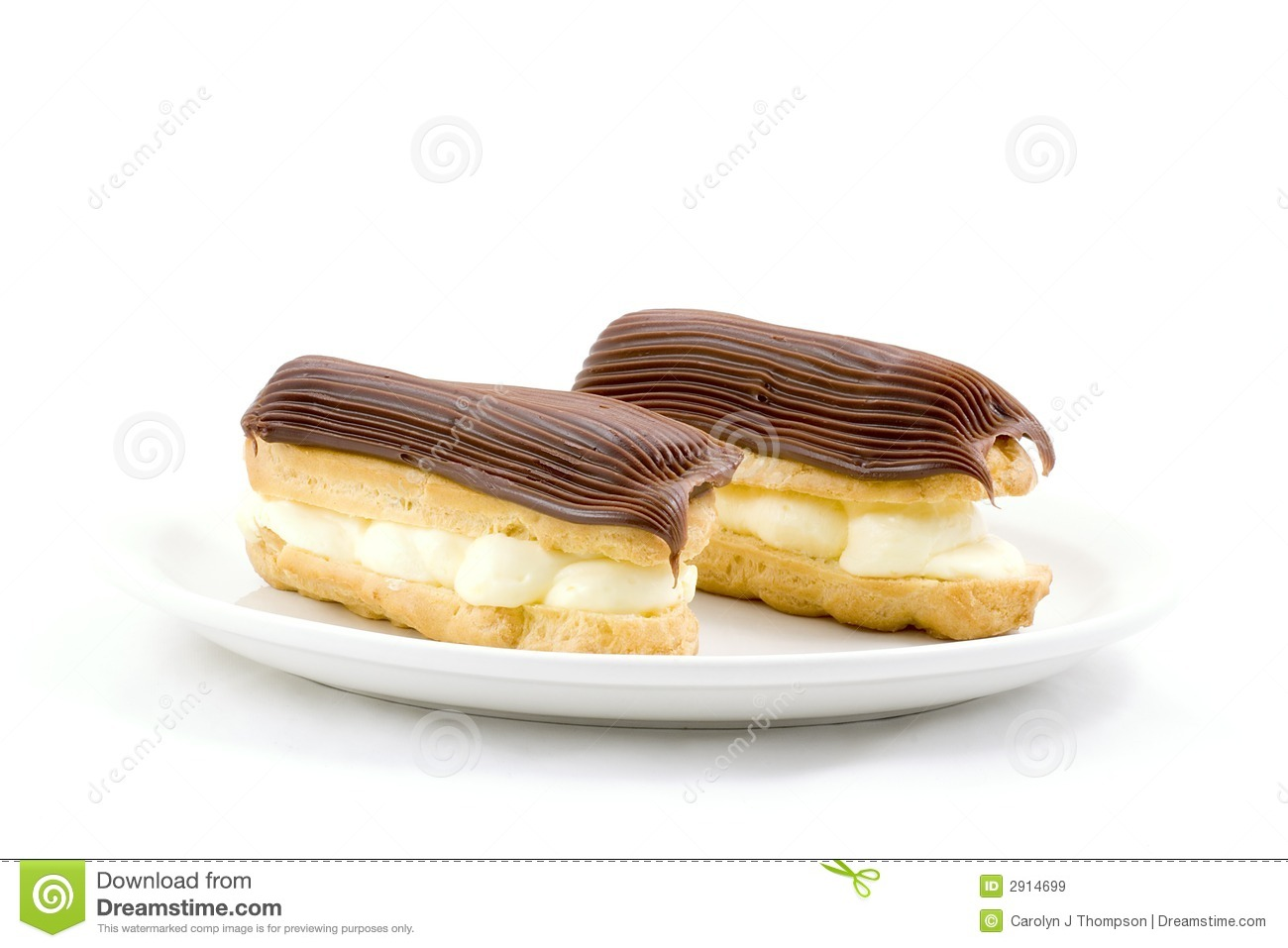 Two chocolate frosted eclairs on a white plate.