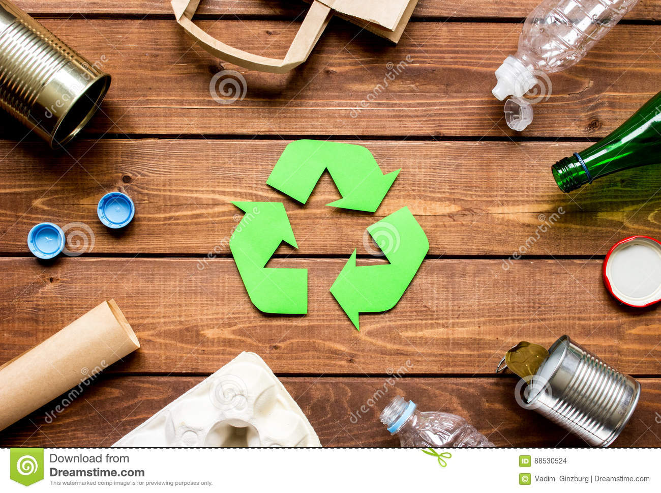 Eco concept with recycling symbol on table background top view