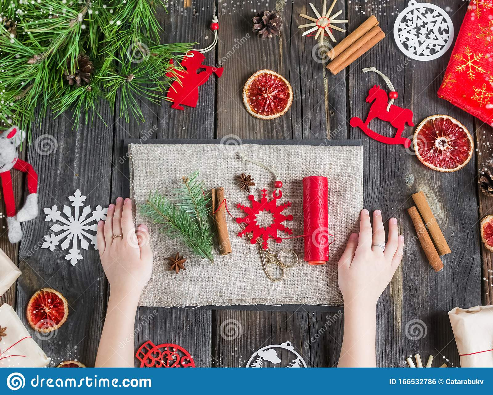 Eco Decor Diy Christmas Composition On A Rustic Wooden Background With Natural Toys Spruce Branches Oranges Stock Photo Image Of Santa Package 166532786