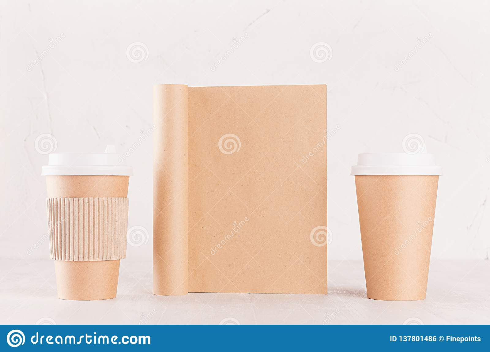 Eco friendly coffee template for design, advertising and branding - two brown paper cups and blank notebook on white wood shelf.