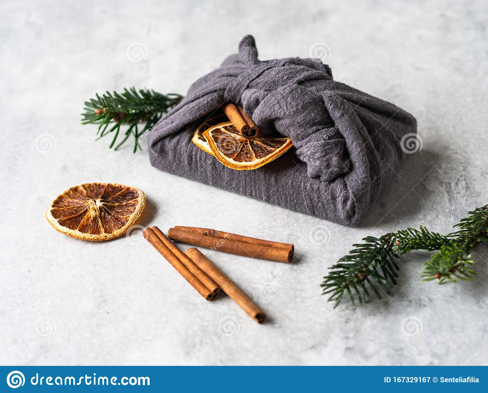 Eco Friendly Fabric Reusable Gift Packaging With Fir Brunch Cinnamon Stick And Dry Orange Slice Christmas Reusable Sustainable Stock Image Image Of Environment Present 167329167