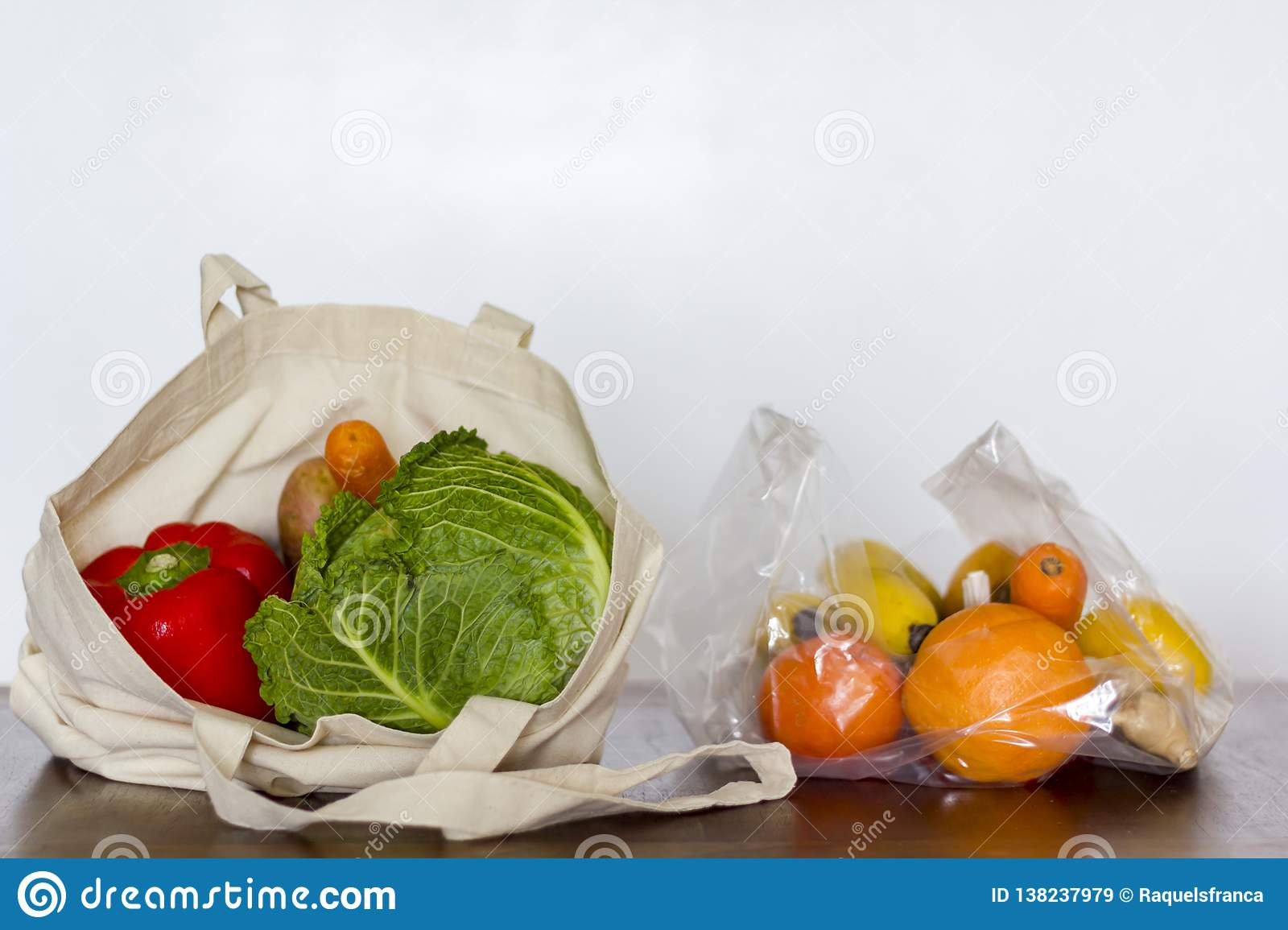 Eco reusable bag with vegetables and plastic bag with fruits
