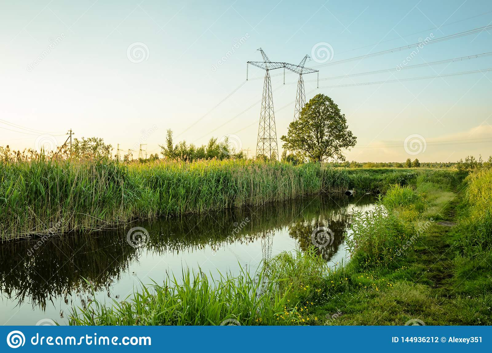 Ecology concept: sewage from the sewer pollutes a lake river/water gushing from the sewer to the river
