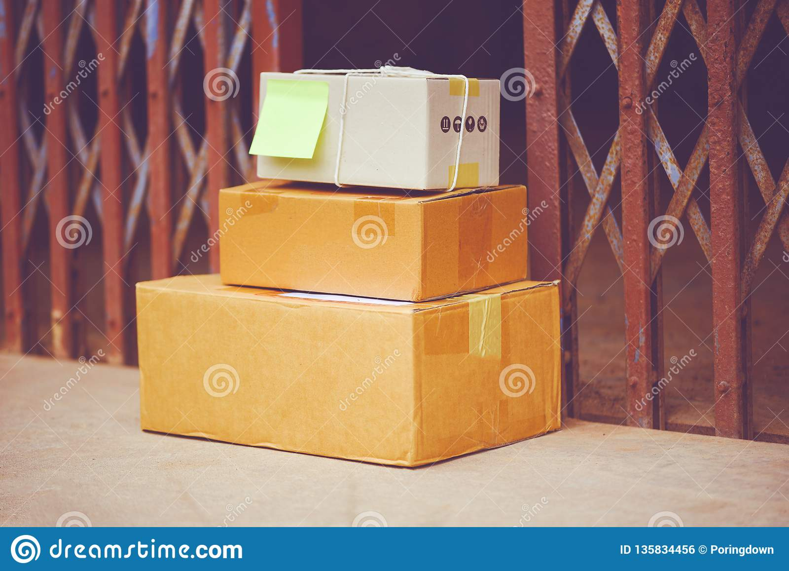 Ecommerce delivery shopping online and order concept - delivered parcels on floor near front door steel