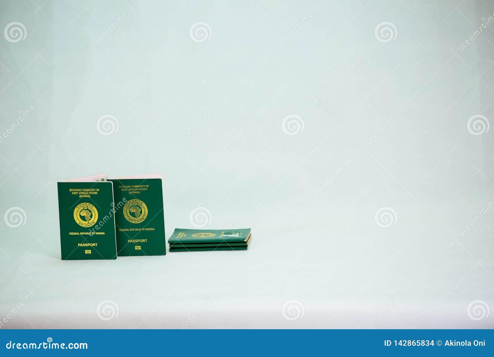 Ecowas nigeria Internation passport on heap of naira cash