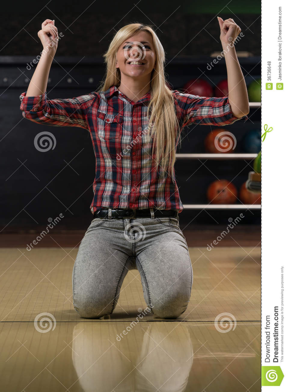 Ecstatic Bowling Women With Raised Hands Stock Photo