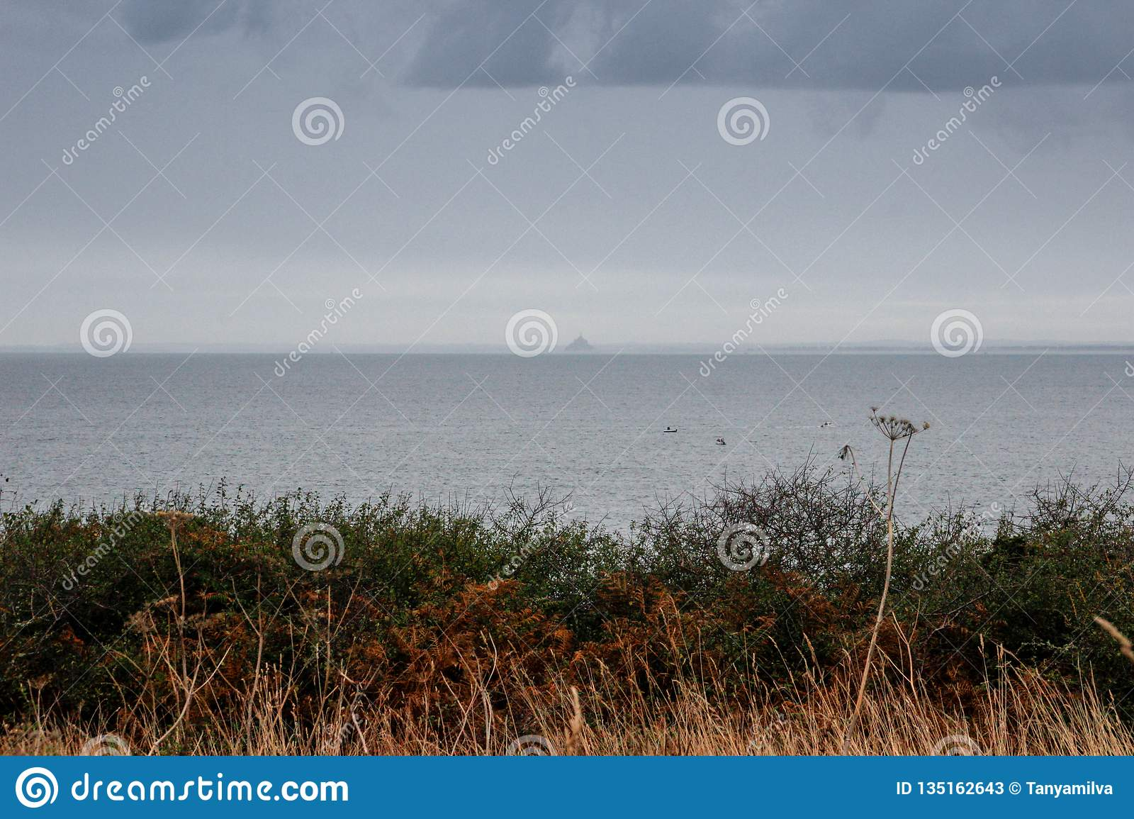 The edge of the land in the north of French Brittany is Pointe du Grouin on a rainy autumn day.