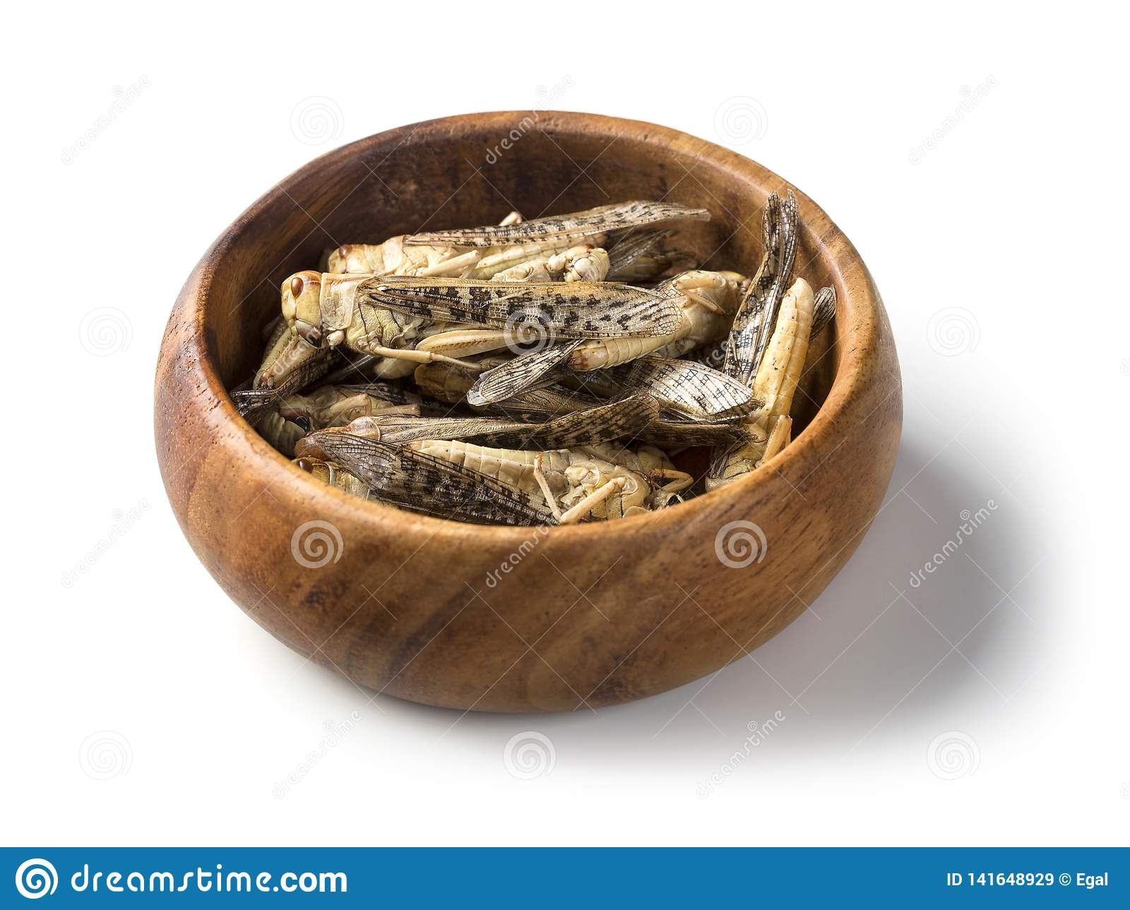 Edible grasshoppers in a wooden bowl