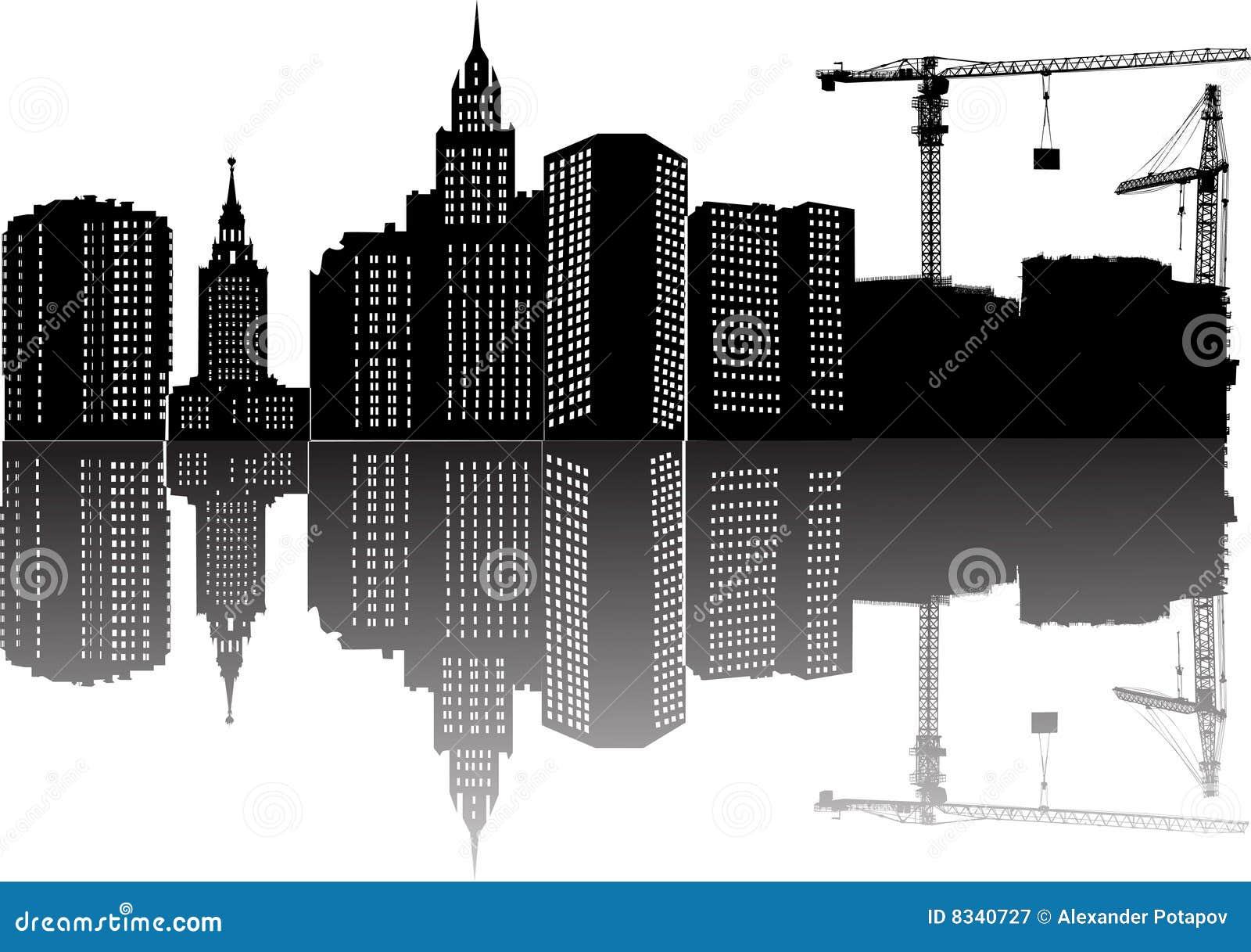 Edifício, guindastes e reflexão
